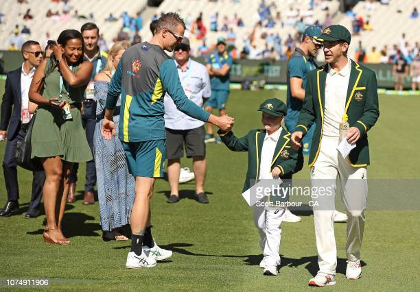 Tim Paine of Australia and Archie Shiller from the Make A Wish foundation who will be cocaptain on Boxing Day look on during day one of the Third...