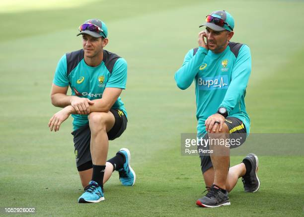 Tim Paine of Australia and Justin Langer coach of Australia look on during day four of the First Test match in the series between Australia and...