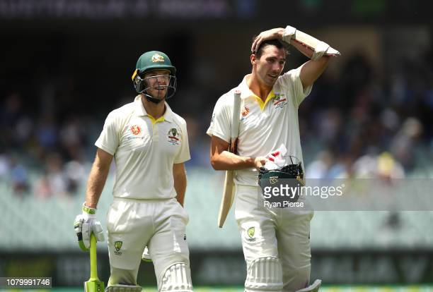 Tim Paine of Australia and Pat Cummins of Australia walk form the ground at lunch during day five of the First Test match in the series between...