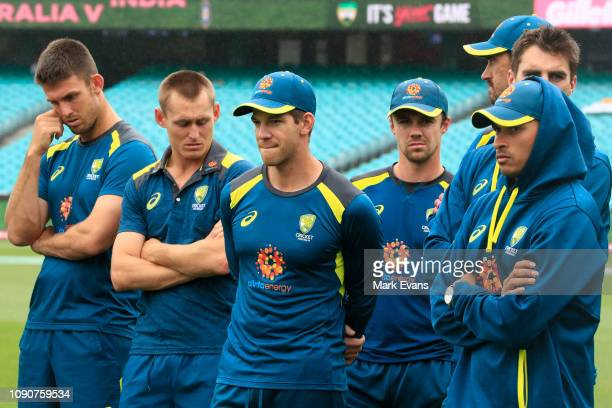 Tim Paine of Australia and team mates look on after India's 21 series win on day five of the Fourth Test match in the series between Australia and...