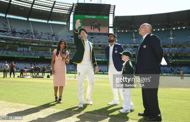 Tim Paine of Australia and Virat Kohli of India during the coin toss as Archie Shiller from the Make A Wish foundation who will be cocaptain on...