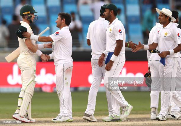 Tim Paine of Australia and Yasir Shah of Pakistan shake hands after the test was drawn during day five of the First Test match in the series between...