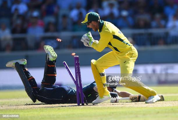 Tim Paine of Australia attempts to run out Jos Butlter of England during the 5th Royal London ODI match between England and Australia at Emirates Old...