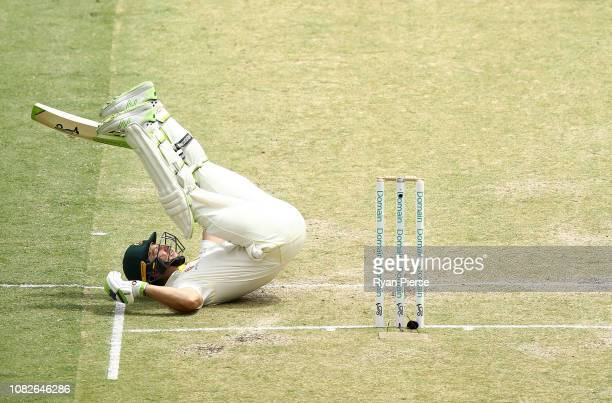 Tim Paine of Australia avoids a short ball from Mohammed Shami of India during day two of the second match in the Test series between Australia and...