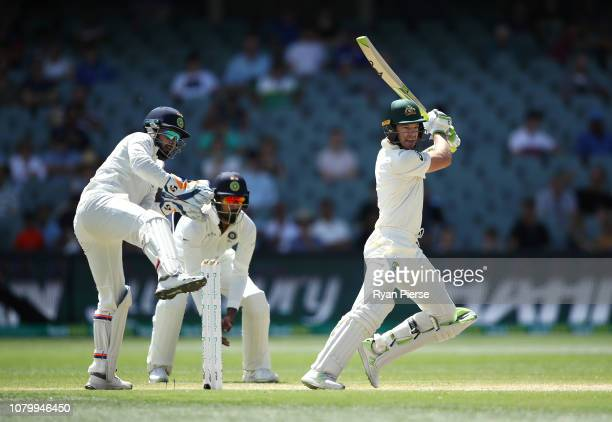 Tim Paine of Australia bats as Rishabh Pant of India keeps wicket during day five of the First Test match in the series between Australia and India...