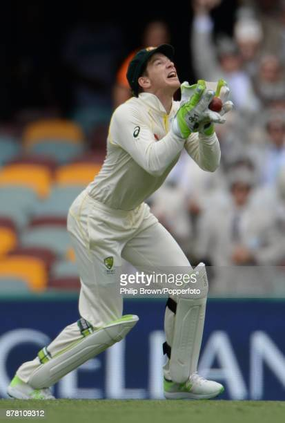 Tim Paine of Australia catches Jonny Bairstow of England on the second day of the first Ashes cricket test match between Australia and England at the...