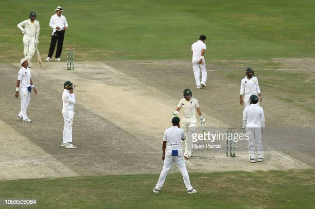 Tim Paine of Australia celebrates after blocking the final ball off Yasir Shah of Pakistan to draw the test match during day five of the First Test...