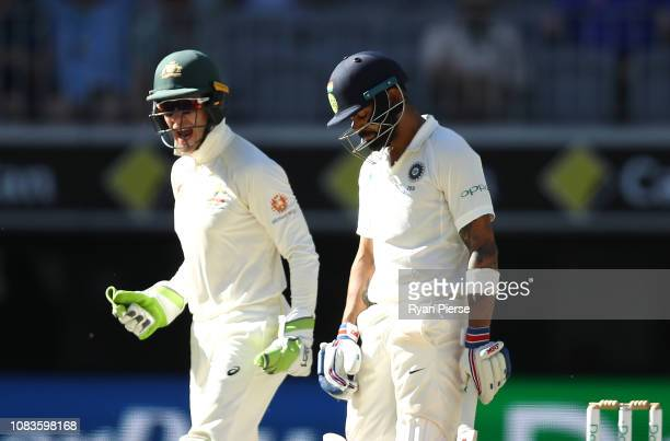 Tim Paine of Australia celebrates as Virat Kohli of India looks dejected after he was dismissed by Nathan Lyon of Australia during day four of the...