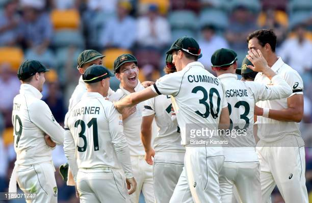 Tim Paine of Australia celebrates with his team mates after dismissing Shaheen Shah Afridi of Pakistan during day one of the 1st Domain Test between...