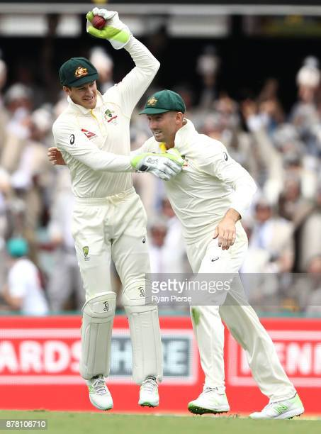 Tim Paine of Australia celebrateswith Shaun Marsh of Australia after taking a catch to dismiss Jonny Bairstow of England off the bowling of Pat...