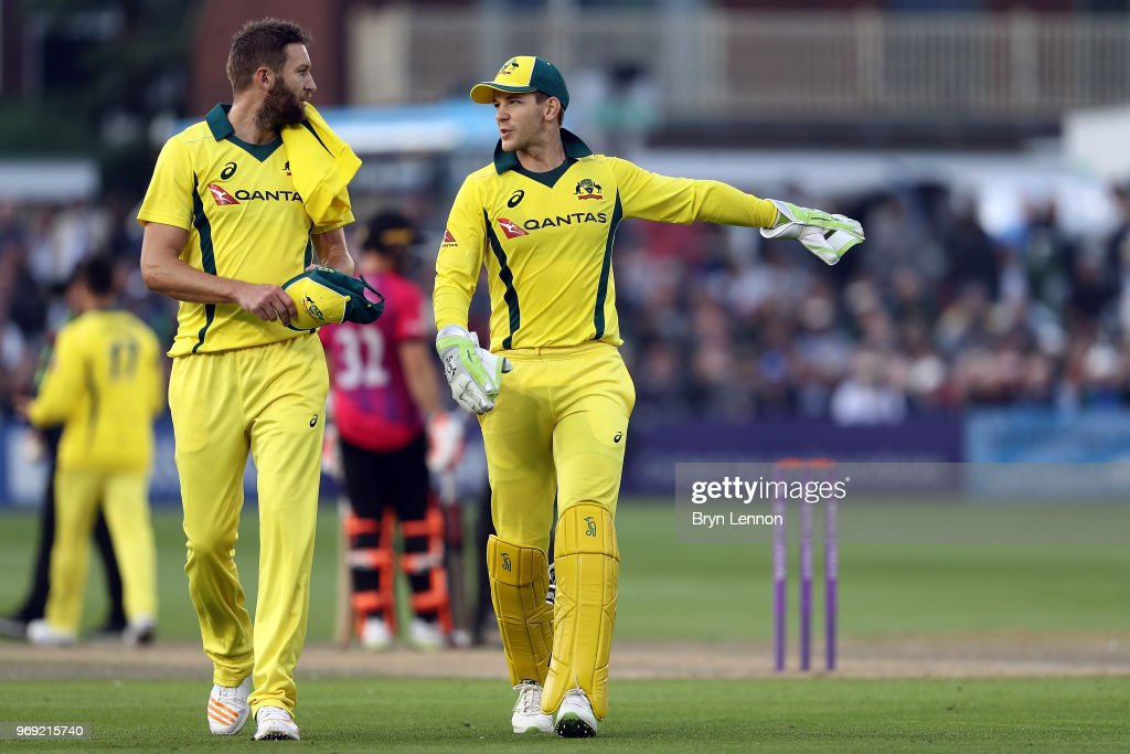 Tim Paine (r) of Australia chats to team mate Andrew Tye during the one day tour match between Sussex and Australia at The 1st Central County Ground on June 7, 2018 in Hove, England.