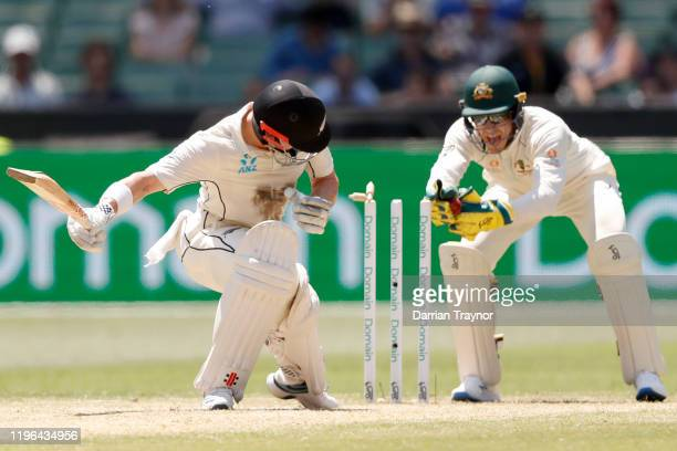 Tim Paine of Australia completes a stumping of Henry Nicholls of New Zealand off the bowling of Nathan Lyon of Australia during day four of the...