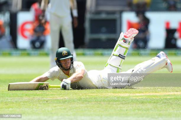 Tim Paine of Australia dives to avoid being run out during day three of the Third Test match in the series between Australia and India at Melbourne...