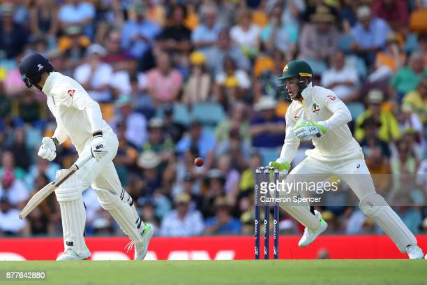 Tim Paine of Australia drops a catch off a delivery by team mate Nathan Lyon during day one of the First Test Match of the 2017/18 Ashes Series...