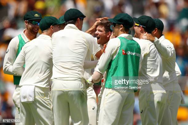 Tim Paine of Australia is congratulated by team mates following a successful DRS decision on the stumping of Moeen Ali of England during day four of...