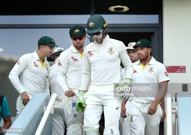Tim Paine of Australia leads his team out during day four of the First Test match in the series between Australia and Pakistan at Dubai International...