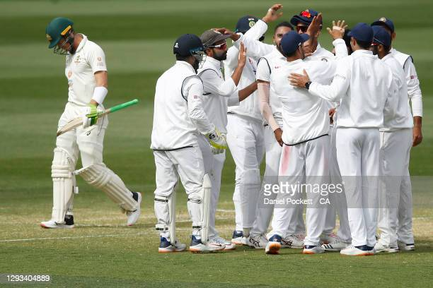 Tim Paine of Australia leaves the field after being dismissed by Ravindra Jadeja of India during day three of the Second Test match between Australia...