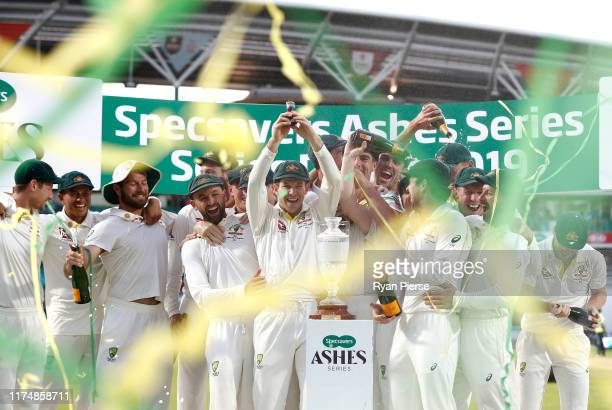 Tim Paine of Australia lifts the Urn after Australian drew the series to retain the Ashes during day four of the 5th Specsavers Ashes Test between...