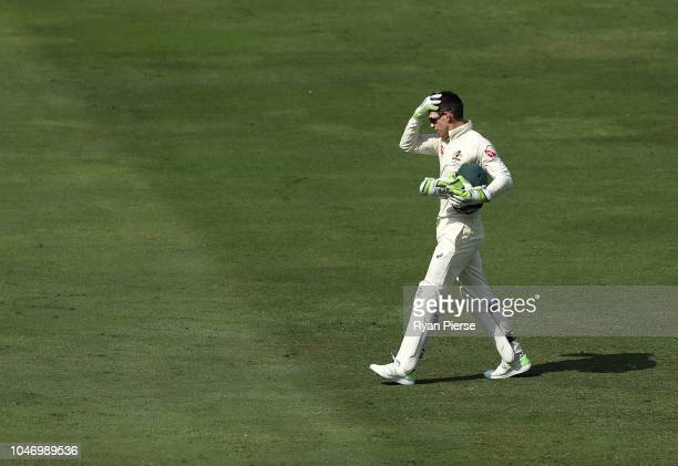Tim Paine of Australia looks on during day one of the First Test match in the series between Australia and Pakistan at Dubai International Stadium on...