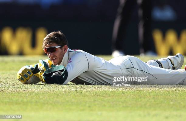Tim Paine of Australia reacts after dropping a catch off Hanuma Vihari of India during day five of the 3rd Test match in the series between Australia...