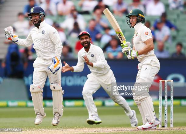 Tim Paine of Australia reacts after his dismissal as Rishabh Pant of India celebrates during day four of the Third Test match in the series between...