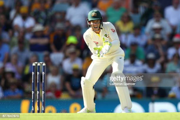 Tim Paine of Australia reacts during day one of the First Test Match of the 2017/18 Ashes Series between Australia and England at The Gabba on...