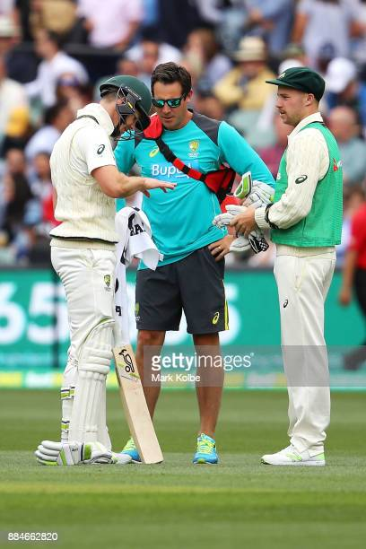 Tim Paine of Australia receives attention after being hit in the hand while batting during day two of the Second Test match during the 2017/18 Ashes...