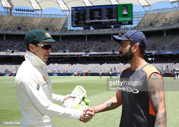 Tim Paine of Australia shakes hands with Virat Kohli of India after Australia claimed victory during day five of the second match in the Test series...