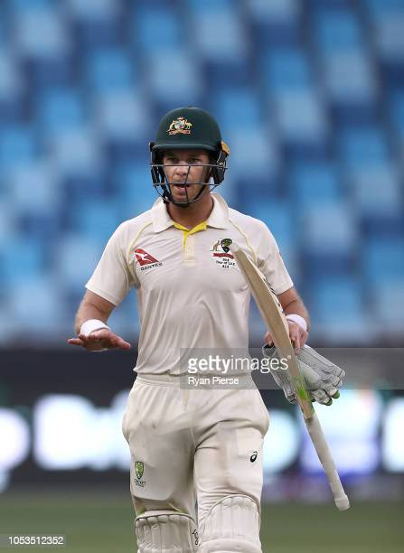 Tim Paine of Australia signals to the change rooms after Australia held on to draw the test match during day five of the First Test match in the...