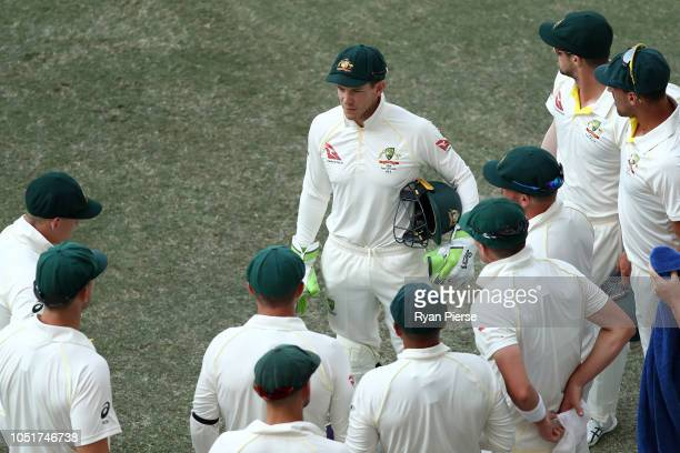 Tim Paine of Australia speaks to his players at the innings change during day three of the First Test match in the series between Australia and...
