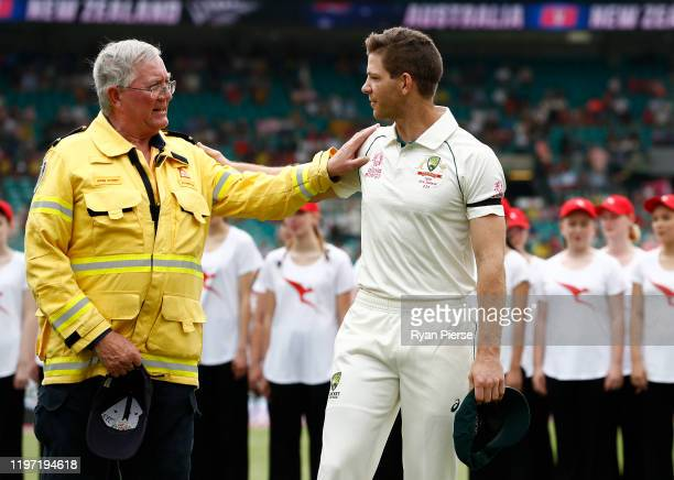 Tim Paine of Australia speaks to Kuringgai Fire Brigade Volunteer John Corry during day one of the Third Test match in the series between Australia...