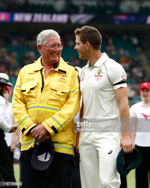 Tim Paine of Australia speaks to Ku-ring-gai Fire Brigade Volunteer John Corry during day one of the Third Test match in the series between Australia...