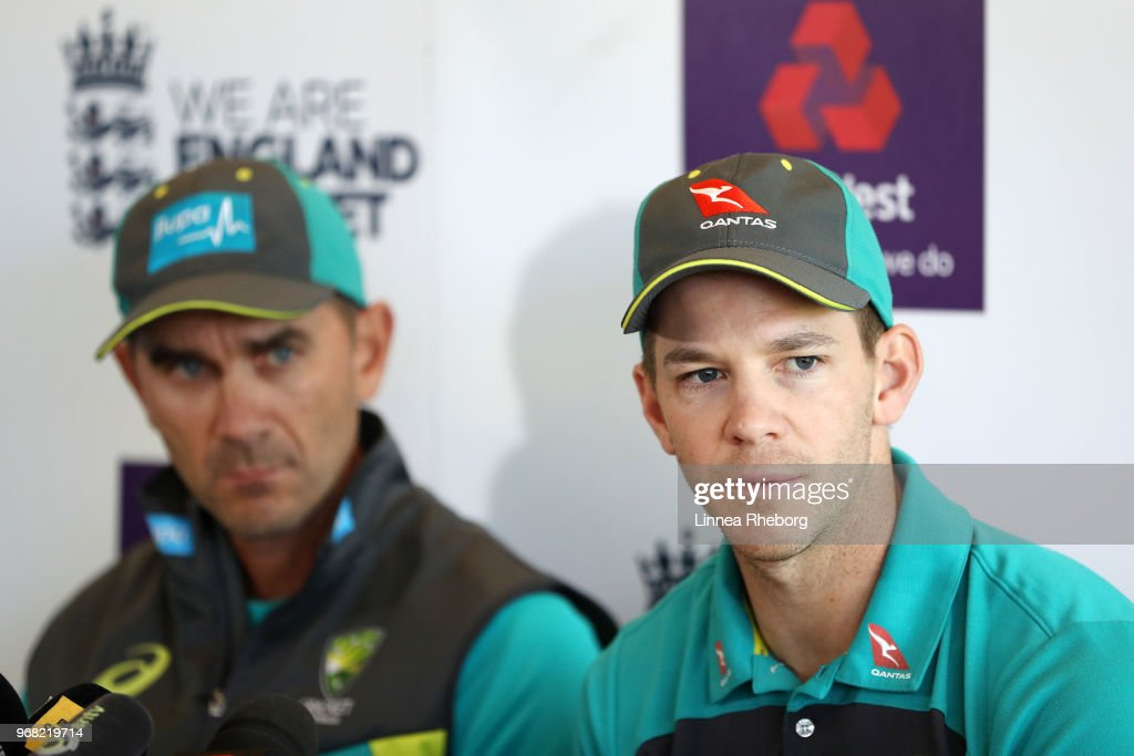 Tim Paine of Australia (R) speaks to the media as Justin Langer, Manager of Australia (L) looks on during a press conference at Lord's Cricket Ground on June 6, 2018 in London, England.