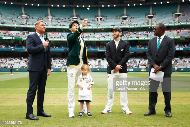 Tim Paine of Australia tosses the coin along side Kane Williamson of New Zealand ahead of day one of the Second Test match in the series between...