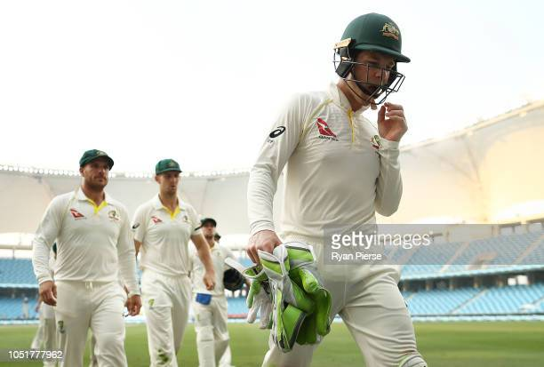 Tim Paine of Australia walks from the ground at stumps during day three of the First Test match in the series between Australia and Pakistan at Dubai...