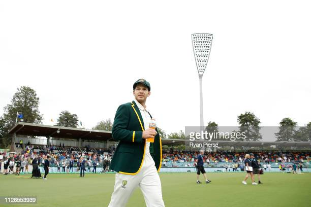 Tim Paine of Australia walks out for the coin toss during day one of the Second Test match between Australia and Sri Lanka at Manuka Oval on February...