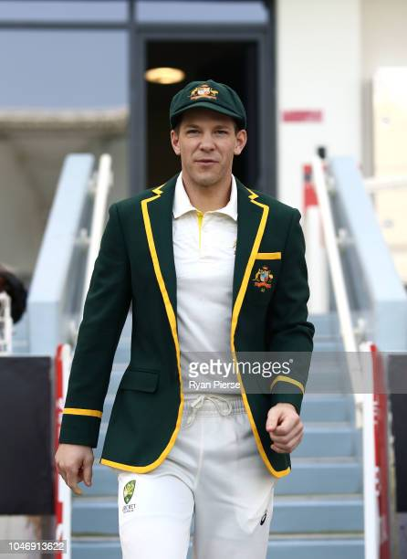 Tim Paine of Australia walks out for the coin toss in his Captain's Blazer during day one of the First Test match in the series between Australia and...