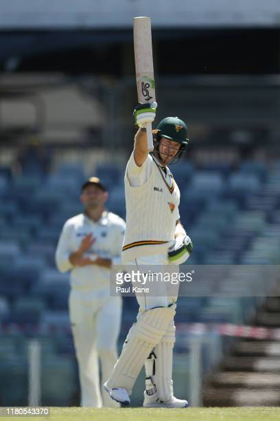 Tim Paine of Tasmania celebrates his century during day three of the Sheffield Shield match between Western Australia and Tasmania at the WACA on...