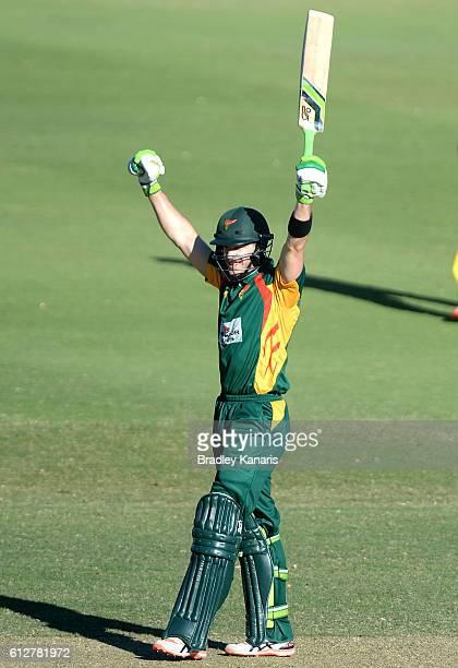 Tim Paine of Tasmania celebrates scoring a century during the Matador BBQs One Day Cup match between Tasmania and the Cricket Australia XI at Allan...