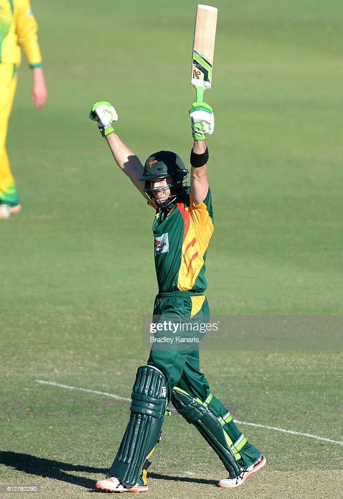 Tim Paine of Tasmania celebrates scoring a century during the Matador BBQs One Day Cup match between Tasmania and the Cricket Australia XI at Allan Border Field on October 5, 2016 in Brisbane, Australia.