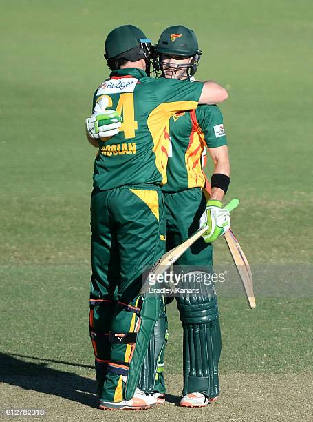 Tim Paine of Tasmania celebrates scoring a century with team mate Alex Doolan during the Matador BBQs One Day Cup match between Tasmania and the...