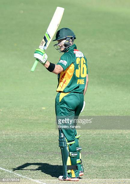 Tim Paine of Tasmania celebrates scoring a half century during the Matador BBQs One Day Cup match between Tasmania and the Cricket Australia XI at...