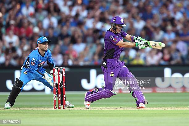 Tim Paine of the Hobart Hurricanes bats in front of Tim Ludeman of the Adelaide Strikers during the Big Bash League match between the Adelaide...