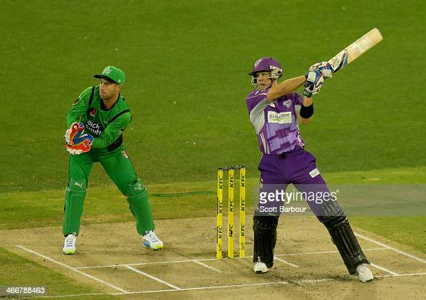 Tim Paine of the Hurricanes bats as Stars wicketkeeper Matthew Wade looks on during the Big Bash League Semi Final match between the Melbourne Stars...