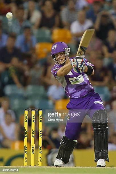 Tim Paine of the Hurricanes bats during the Big Bash League match between Brisbane Heat and the Hobart Hurricanes at The Gabba on December 28 2013 in...