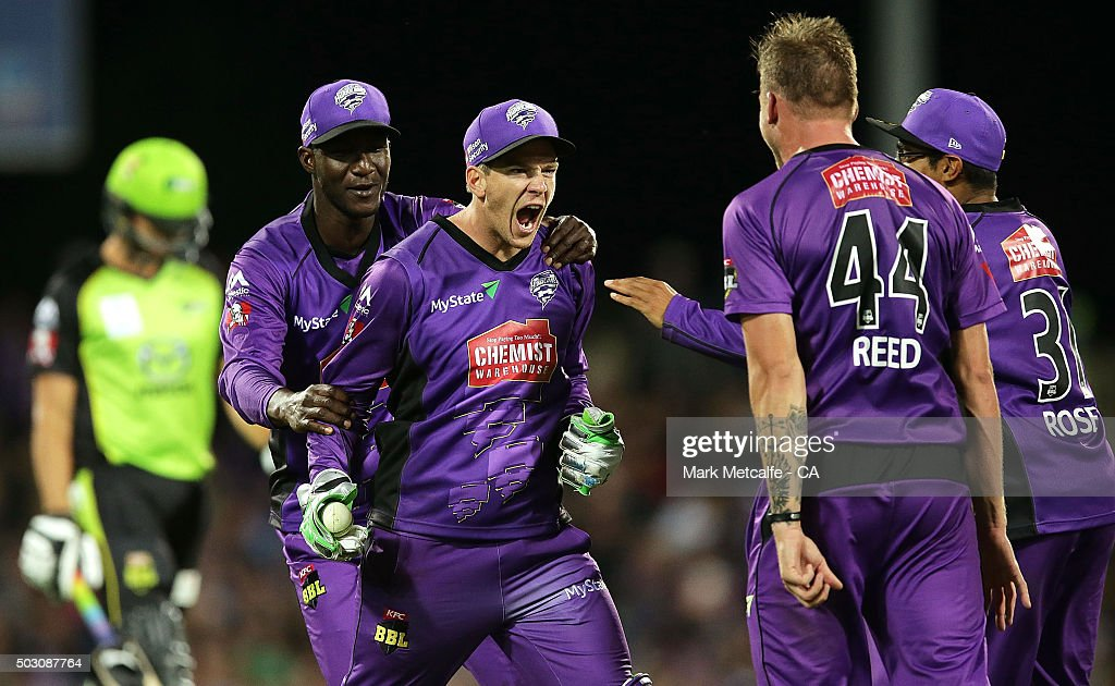 Tim Paine of the Hurricanes celebrates with team mates after taking the wicket of Chris Green of the Thunder during the Big Bash League match between the Hobart Hurricanes and the Sydney Thunder at Blundstone Arena on January 1, 2016 in Hobart, Australia.