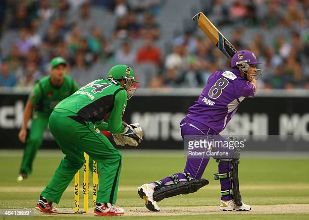 Tim Paine of the Hurricanes hits out on the first ball during the Big Bash League match between the Melbourne Stars and the Hobart Hurricanes at...