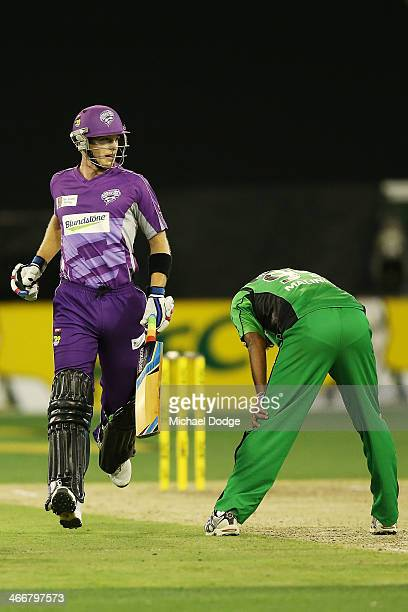 Tim Paine of the Hurricanes runs past Lasith Malinga of the Stars during the Big Bash League Semi Final match between the Melbourne Stars and the...