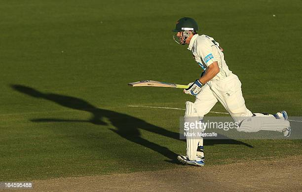 Tim Paine of the Tigers runs between wickets day four of the Sheffield Shield final between the Tasmania Tigers and the Queensland Bulls at...