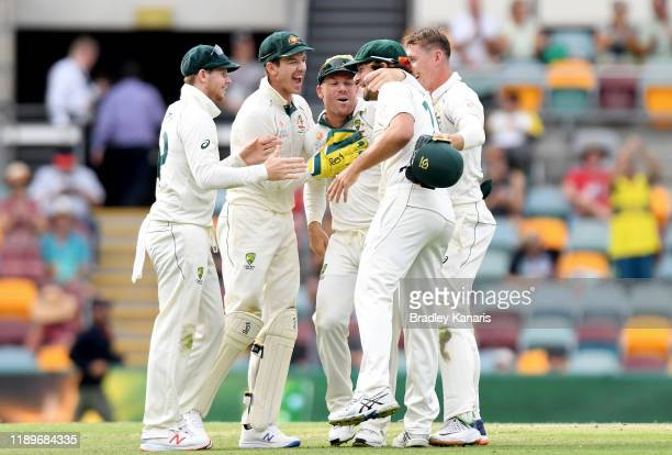 Tim Paine, Steve Smith, Joe Burns, David Warner and Marnus Labuschagne of Australia celebrate victory during day four of the 1st Domain Test between...